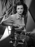 Joan Bennett sitting and Crossing Legs Portrait Photo by  Movie Star News
