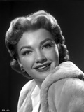 Anne Baxter on a Soft Coat smiling and posed Photo by  Movie Star News