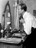 Fred Astaire Fixing Tie in Black and White Photo by  Movie Star News