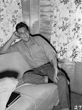 Elvis Presley Leaning on Bed Black and White Photo by  Movie Star News