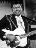 Claude Akins Playing Guitar With Black Suit Photo by  Movie Star News