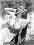 Carole Landis on a Dress sitting and Leaning Photo by  Movie Star News