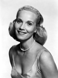 Eva Saint smiling in Classic with Necklace Photo by  Movie Star News