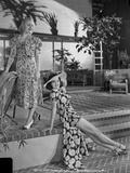 Rita Hayworth posed in Swimwear with A Woman Photo by  Movie Star News