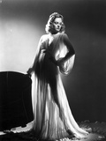 Alexis Smith standing wearing a Silk Robe Photo by  Movie Star News