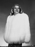 Rita Hayworth Posed in White Furry Garment Photo by Robert Coburn