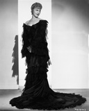 Jeanette MacDonald standing in Black Dress Photo by  Movie Star News