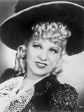 Mae West smiling in Glamorous Dress with Hat Photo by  Movie Star News