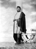 Peter Ustinov Leaning on Wall in White Dress Photo by  Movie Star News