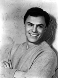 John Saxon sitting on Net With Arm's Cross Photo by  Movie Star News