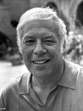 George Kennedy smiling in White polo shirt Photo by  Movie Star News