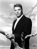 Burt Lancaster in Black Suit Holding a Twig Photo by  Movie Star News