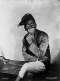 Al Jolson sitting while Giving A Big Smile Photo by Florence Vandamm