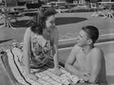Ronald Reagan Talking to a Sunbathing Woman Photo by  Movie Star News
