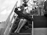 Anne Baxter on a Coat and sitting on a Stair Photo by  Movie Star News