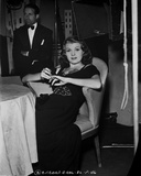 Rita Hayworth Lounging on Chair in Black Gown Photo by  Movie Star News
