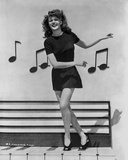 Rita Hayworth in Musical Notes Background Photo by Ned Scott