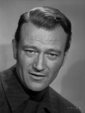John Wayne wearing a Black Outfit in a Portrait Photo by  Freulich