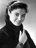 Marisa Pavan Posed in Black Suit with a Smile Photo by  Movie Star News