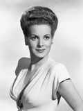 Maureen O'Hara smiling in Deep V-neck Dress Photo by E Bachrach