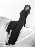 Rita Hayworth Leaning on Bed in Black Dress Photo by Robert Coburn