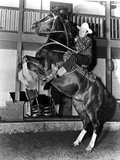 Gene Autry Riding a Horse in Cowboy Attire Photo by  Movie Star News