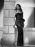 Rita Hayworth Leaning on Wall in Black Gown Photo by Robert Coburn