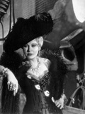 Mae West Leaning in Black Dress with Black Hat Photo by  Movie Star News