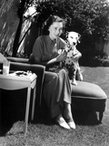 Maureen O'Sullivan sitting with a Dalmatian Photo by  Movie Star News