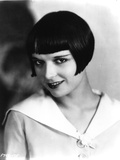 Louise Brooks smiling in White Dress Portrait Photo by  Movie Star News