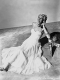 Rita Hayworth posed in Long Gown with Telephone Photo by Ned Scott