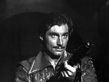 Timothy Dalton in Leather Jacket With Pistol Photo by  Movie Star News
