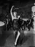 Rita Hayworth Performing in High Slit Dress Photo by Ned Scott