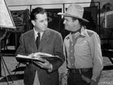 Gene Autry Talking to a Man Holding a Book Photo by  Movie Star News
