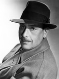 Cedrick Hardwickle in Coat With Hat Portrait Photo by  Movie Star News