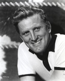 Kirk Douglas smiling in White Polo Portrait Photo by  Movie Star News