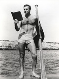 Sean Connery Reading on Raft in Black and White Photo by  Movie Star News
