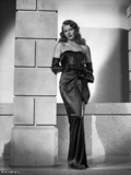 Rita Hayworth Leaning on Wall in Black Dress Photo by Robert Coburn