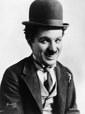 Charlie Chaplin smiling in a Coat and Tie Photo by  Movie Star News