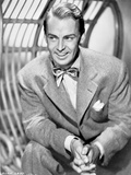 Alan Ladd sitting and Giving Out a Big Smile Photo by  Movie Star News