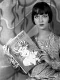 Louise Brooks Posed in Floral Dress with Book Photo by  Movie Star News
