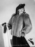 Rita Hayworth posed with Furry Dress and Hat Photo by Robert Coburn