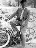 Morgan Freeman Riding Bike in Suit With Cap Photo by  Movie Star News