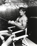Robert Mitchum Seated and Fishing on Chair Photo by  Movie Star News