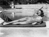 Rita Hayworth Lying on the Side of the Pool Photo by  Movie Star News