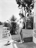 Rita Hayworth posed in A Swimwear with A Dog Photo by  Movie Star News