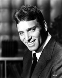 Burt Lancaster in Black Suit and smiling Photo by  Movie Star News