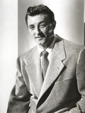 Robert Mitchum smiling in Suit and Tie Photo by  Movie Star News