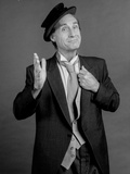 Sid Caesar standing in Classic Portrait Photo by  Movie Star News