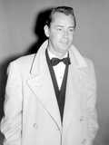 Alan Ladd standing, wearing a Long Coat Photo by  Movie Star News